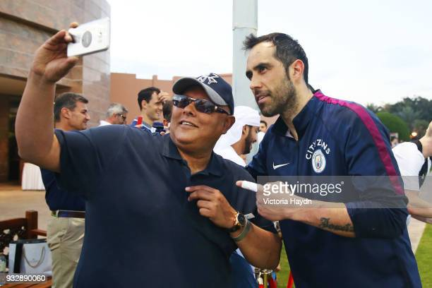 Manchester City's Claudio Bravo interacts with fans during the training session on March 16 2018 in Abu Dhabi United Arab Emirates