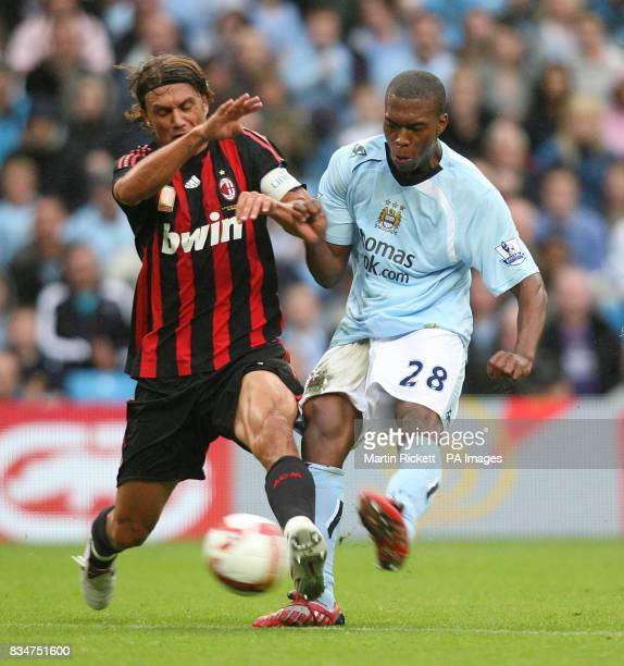 Manchester City's Daniel Sturridge shoots past AC Milan's Paolo Maldini during the friendly match at the City of Manchester Stadium Manchester