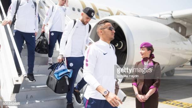 Manchester City's Danilo and Nicolas Otamendi arrive at Abu Dhabi International Airport on March 13 2018 in Abu Dhabi UAE