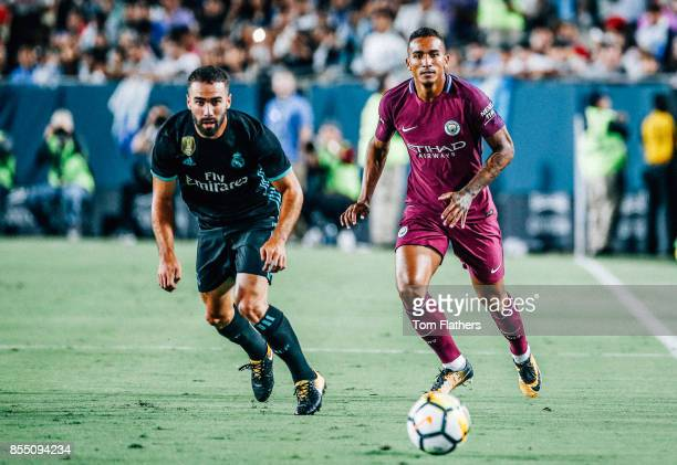 Manchester City's Danilo and Real Madrid's Dani Carvajal in action at the Los Angeles Memorial Coliseum on July 26 2017 in Los Angeles California