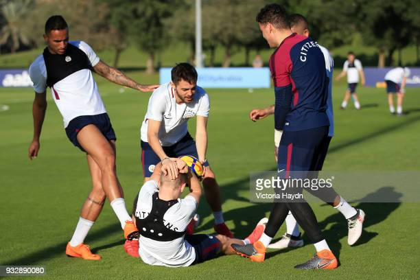 Manchester City's Danilo Bernardo Silva Ederson Moraes and Gabriel Jesus share a joke with Oleksandr Zinchenko during the training session on March...