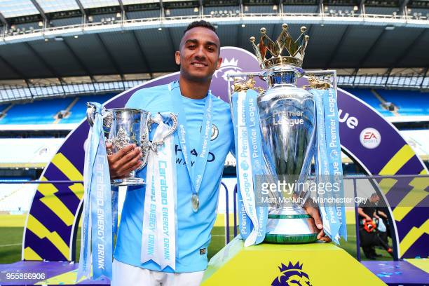 Manchester City's Danilo poses with the Premier League trophy after the Premier League match between Manchester City and Huddersfield Town at Etihad...