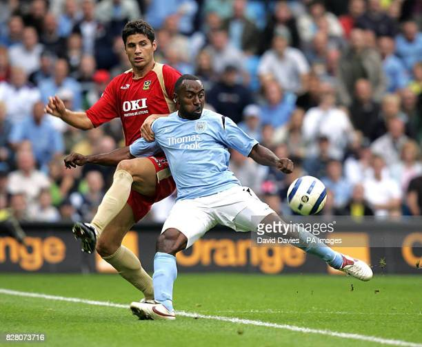 Manchester City's Darius Vassell in action against Portsmouth's Dejan Stefanovic during the FA Barclays Premiership match at the City of Manchester...