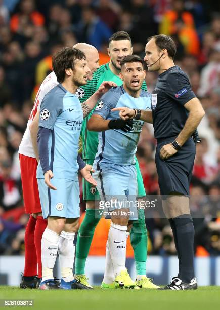 Manchester City's David Silva and Manchester City's Sergio Aguero appeal to match referee Antonio Miguel Mateu Lahoz along with Monaco's Danijel...