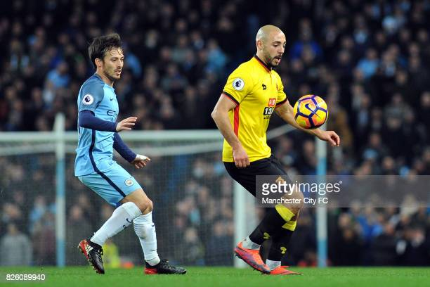Manchester City's David Silva and Watford's Nordin Amrabat in action during the Premiership match at the Etihad Stadium Manchester on 14th December...