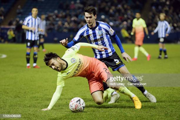 Manchester City's David Silva is tackled by Sheffield Wednesday's Kieran Lee during the FA Cup Fifth Round match between Sheffield Wednesday and...