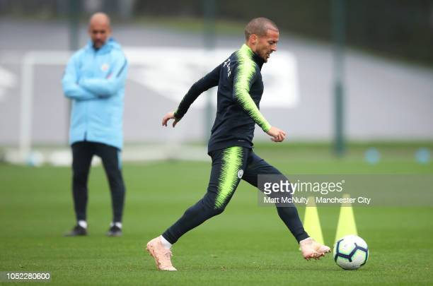 Manchester City's David Silva is watched by manager Pep Guardiola during the training session at Manchester City Football Academy on October 16 2018...