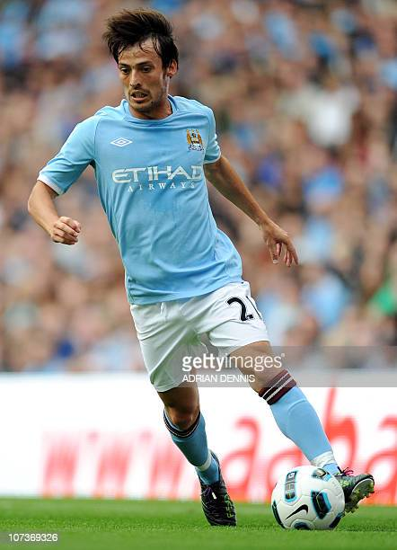 Manchester City's David Silva runs with the ball against Valencia during the international pre-season friendly football match at The City of...