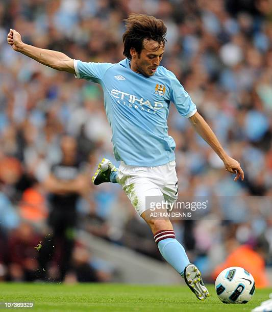 Manchester City's David Silva shoots at goal against Valencia during the international pre-season friendly football match at The City of Manchester...