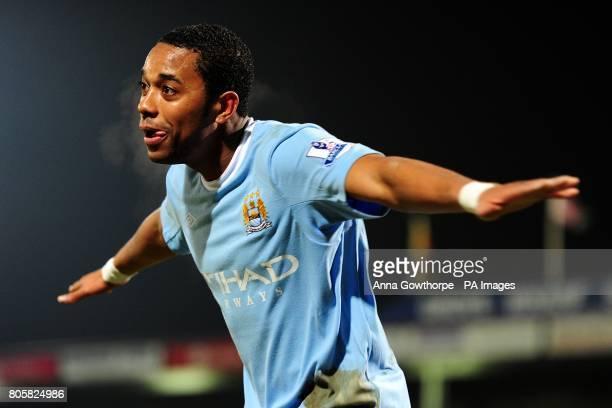 Manchester City's De Souza Robinho celebrates scoring his sides fourth goal of the game