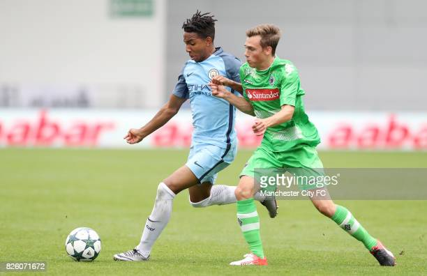 Manchester City's Demeaco Duhaney battles for the ball with Borussia Monchengladbach's Maximillian Muller