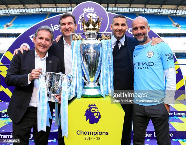 Manchester City's Director of football Txiki Begiristain poses with Chief Executive Ferran Soriano Club Chairman Khaldoon Al Mubarak and manager Pep...