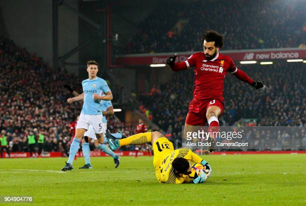 LIVERPOOL ENGLAND JANUARY Manchester City's Ederson beats Liverpool's Mohamed Salah to a ball during the Premier League match between Liverpool and...