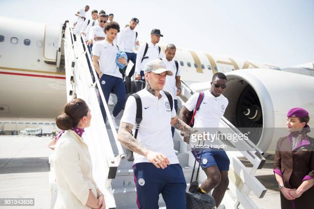 Manchester City's Ederson Benjamin Mendy and teammates arrive at Abu Dhabi International Airport on March 13 2018 in Abu Dhabi UAE