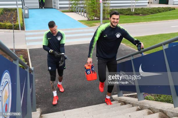 Manchester City's Ederson Moraes and Aro Muric react during training at Manchester City Football Academy on April 25 2019 in Manchester England
