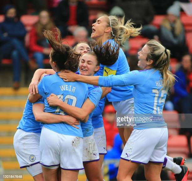 Manchester City's Ellen White celebrates scoring with her teammates during the Women's FA Cup Fourth Round between Manchester United Women v...
