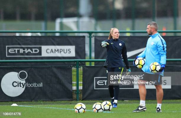Manchester City's Ellie Roebuck talks with goalkeeping coach Chris Williams during the training session at Manchester City Football Academy on...