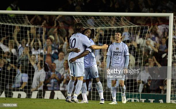 Manchester City's Emile Mpenza hugs Rolando Bianchi after he scores Manchester City's second goal during the Carling Cup second round match between...