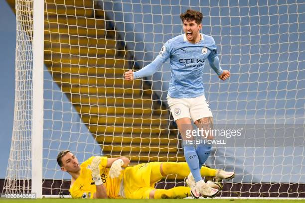 Manchester City's English defender John Stones celebrates after scoring the opening goal during the English Premier League football match between...