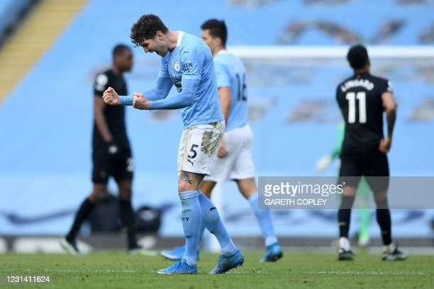 Manchester City's English defender John Stones celebrates at the final whistle during the English Premier League football match between Manchester...