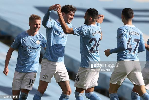 Manchester City's English defender John Stones celebrates scoring his team's second goal during the English Premier League football match between...
