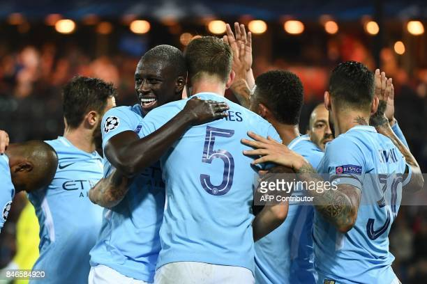 Manchester City's English defender John Stones celebrates with teammates after scoring his second goal during the UEFA Champions League Group F...