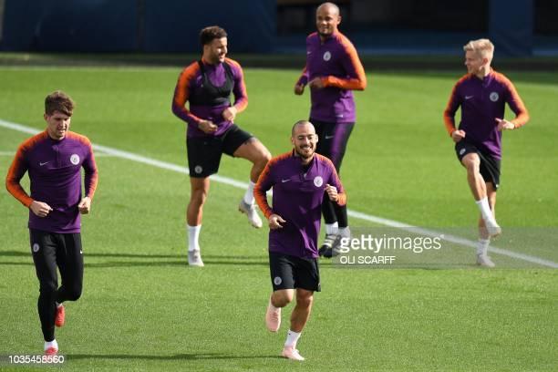 Manchester City's English defender John Stones Manchester City's English defender Kyle Walker Manchester City's Spanish midfielder David Silva...