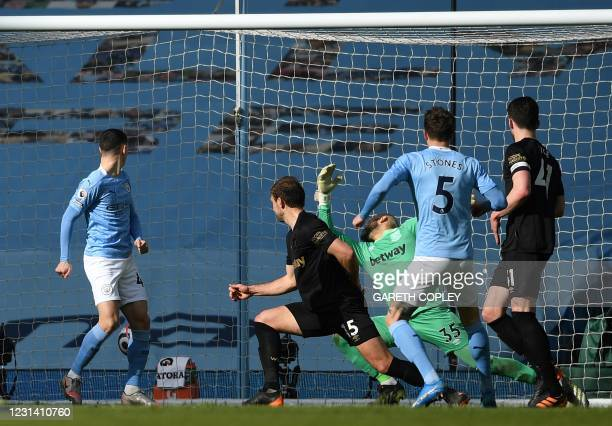 Manchester City's English defender John Stones scores his team's second goal during the English Premier League football match between Manchester City...