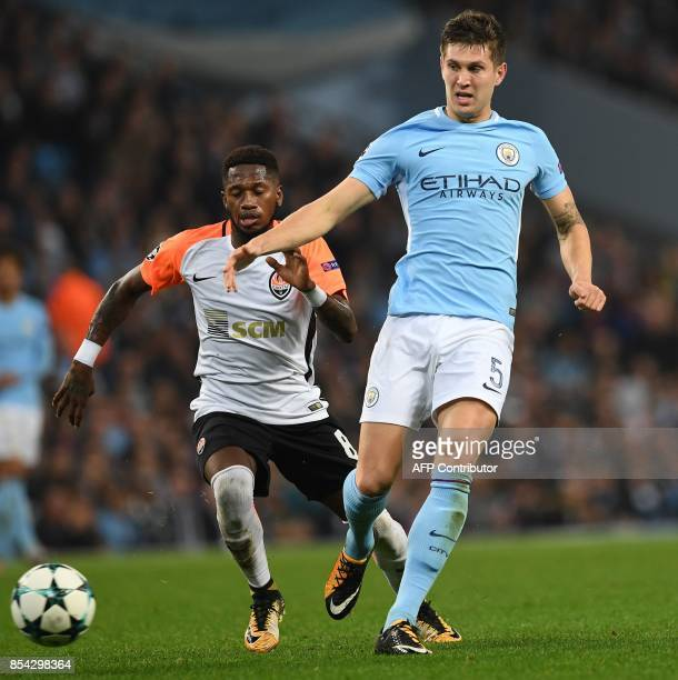 Manchester City's English defender John Stones vies with Shakhtar Donetsk's Brazilian midfielder Fred during the Group F football match between...