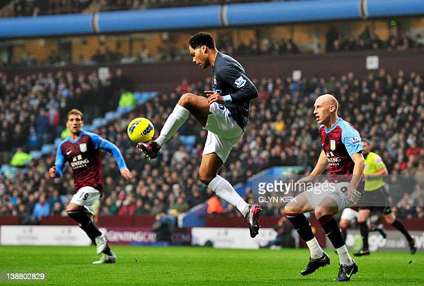Manchester City's English defender Joleon Lescott vies with Aston Villa's Welsh defender James Collins during their English Premier League football...