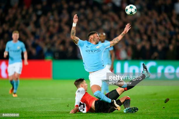 Manchester City's English defender Kyle Walker and Feyenoord's Dutch striker Michiel Kramer fall during the UEFA Champions League Group F football...