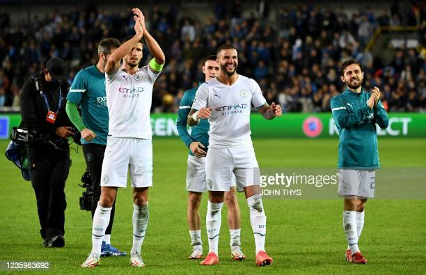 Manchester City's English defender Kyle Walker and team mates celebrate their victory at the end of the UEFA Champions League first round day 3 Group...