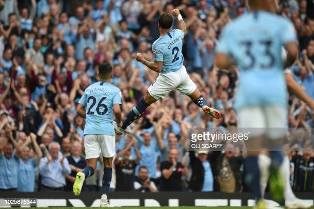 TOPSHOT Manchester City's English defender Kyle Walker celebrates after scoring their second goal during the English Premier League football match...