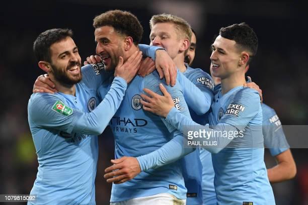 Manchester City's English defender Kyle Walker celebrates with Manchester City's Portuguese midfielder Bernardo Silva after scoring their eighth goal...