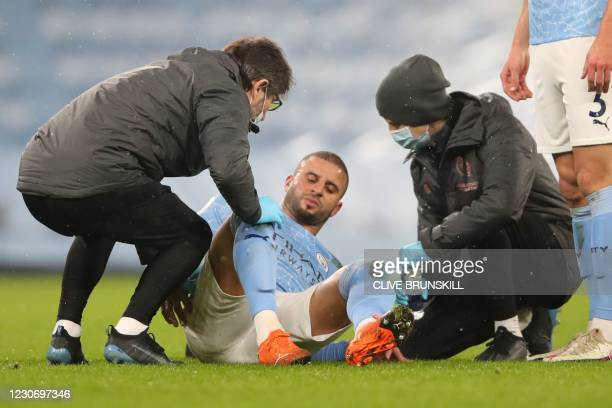 Manchester City's English defender Kyle Walker gets attention on the pitch for an injury during the English Premier League football match between...