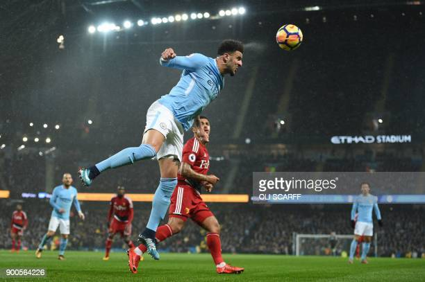 TOPSHOT Manchester City's English defender Kyle Walker heads the ball away during the English Premier League football match between Manchester City...