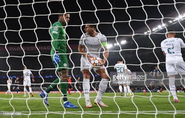 Manchester City's English defender Kyle Walker reacts after Paris Saint-Germain's Senegalese midfielder Idrissa Gana Gueye celebrates scoring his...