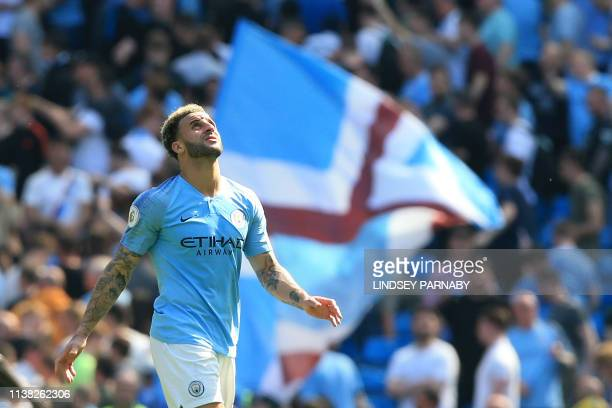 Manchester City's English defender Kyle Walker reacts at the final whistle during the English Premier League football match between Manchester City...