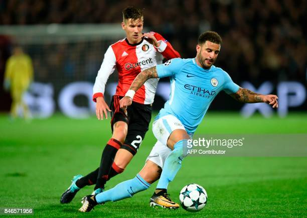 Manchester City's English defender Kyle Walker vies for the ball with Feyenoord's Dutch striker Michiel Kramer during the UEFA Champions League Group...