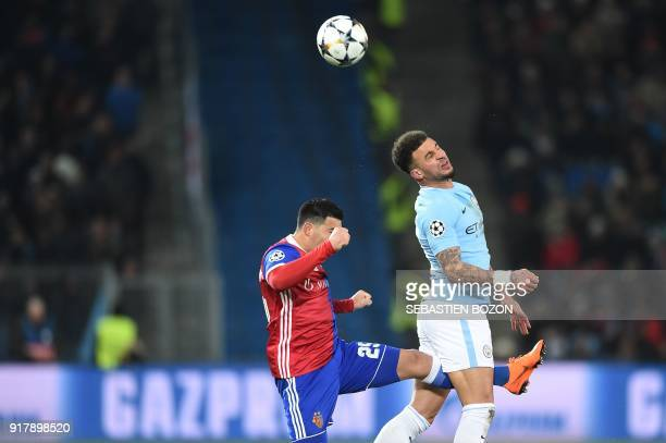 Manchester City's English defender Kyle Walker vies for the ball with Basel's Paraguayan defender Blas Riveros during the UEFA Champions League round...