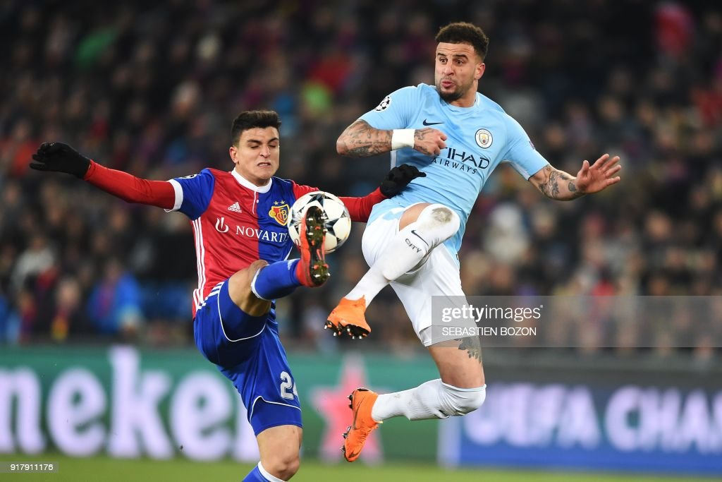Manchester City's English defender Kyle Walker (R) vies for the ball with Basel's Norwegian midfielder Mohamed Elyounoussi (L) during the UEFA Champions League round of 16 first leg football match between Basel and Manchester City at the Saint Jakob-Park Stadium in Basel on February 13, 2018. /