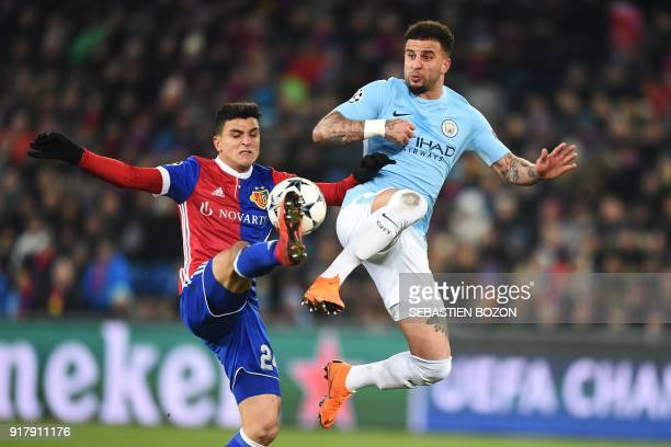 Manchester City's English defender Kyle Walker vies for the ball with Basel's Norwegian midfielder Mohamed Elyounoussi during the UEFA Champions...