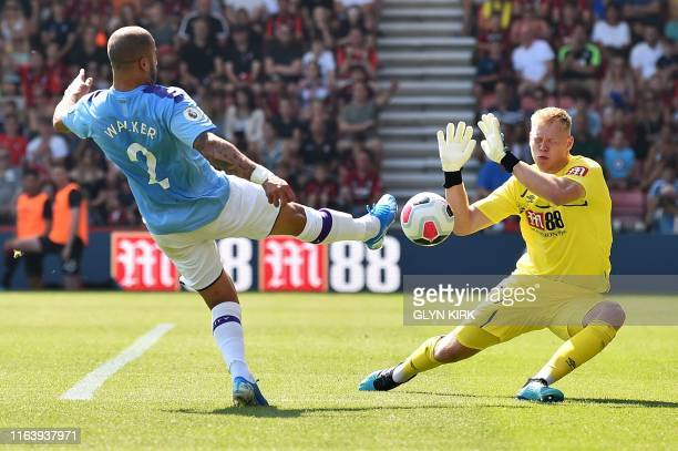 Manchester City's English defender Kyle Walker vies with Bournemouth's English goalkeeper Aaron Ramsdale but is ruled to be off side during the...