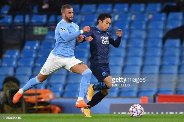 Manchester City's English defender Kyle Walker vies with Marseille's Japanese defender Yuto Nagatomo during the UEFA Champions League 1st round day 6...