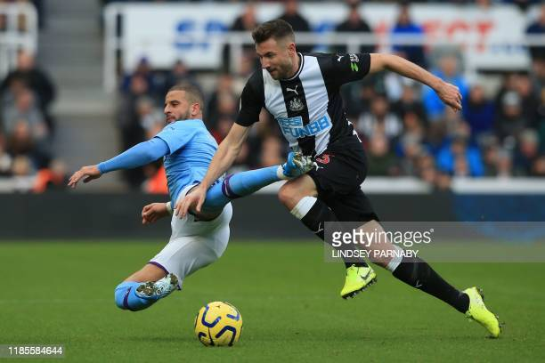 Manchester City's English defender Kyle Walker vies with Newcastle United's Welsh defender Paul Dummett during the English Premier League football...