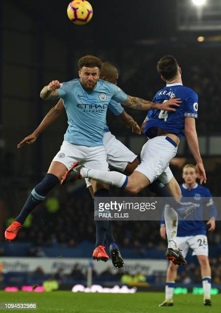 Manchester City's English defender Kyle Walker views in the air to header the ball against Everton's English defender Michael Keane during the...
