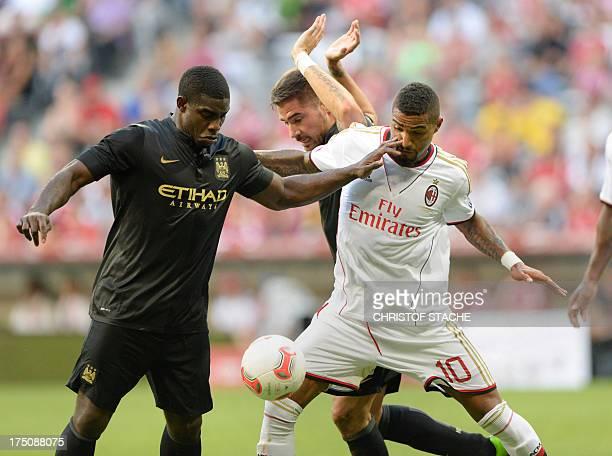Manchester City's English defender Micah Richards Manchester City's Spanish midfielder Javi Garcia and Milan's German midfielder KevinPrince Boateng...