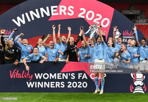 Manchester City's English defender Steph Houghton lifts the trophy after winning the English Women's FA Cup final football match between Everton and...