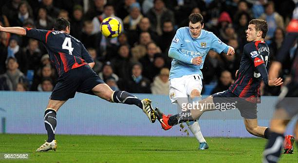 Manchester City's English forward Adam Johnson shoots during the English Premier League football match against Bolton at The City of Manchester...