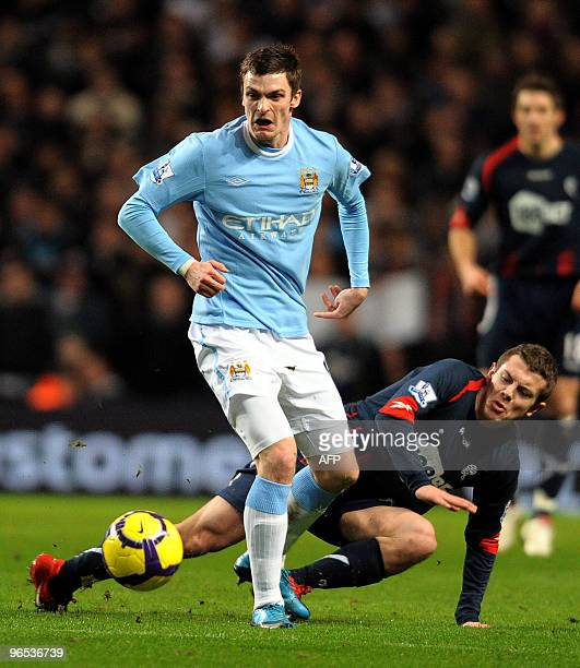Manchester City's English forward Adam Johnson vies with Bolton Wanderers' English midfielder Jack Wilshire during the English Premier League...